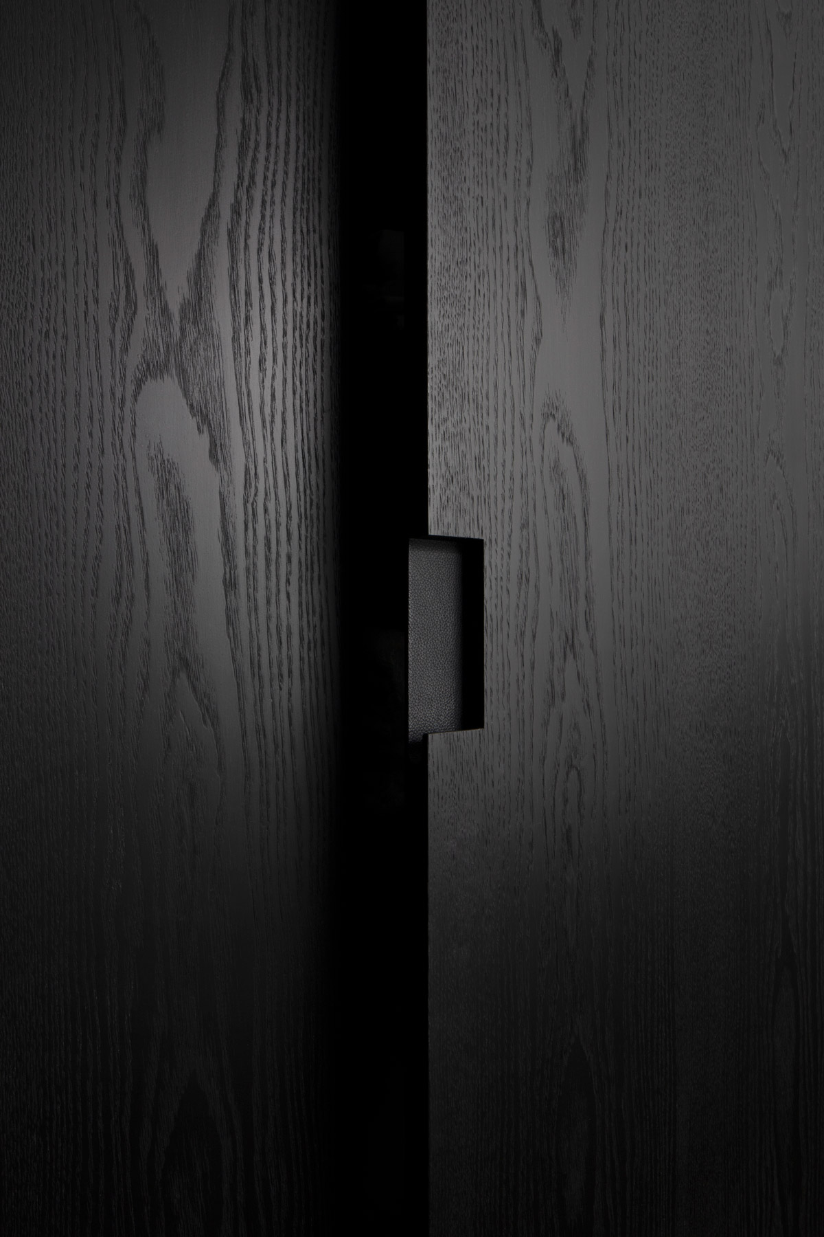 ebonised wood cupboards joinery