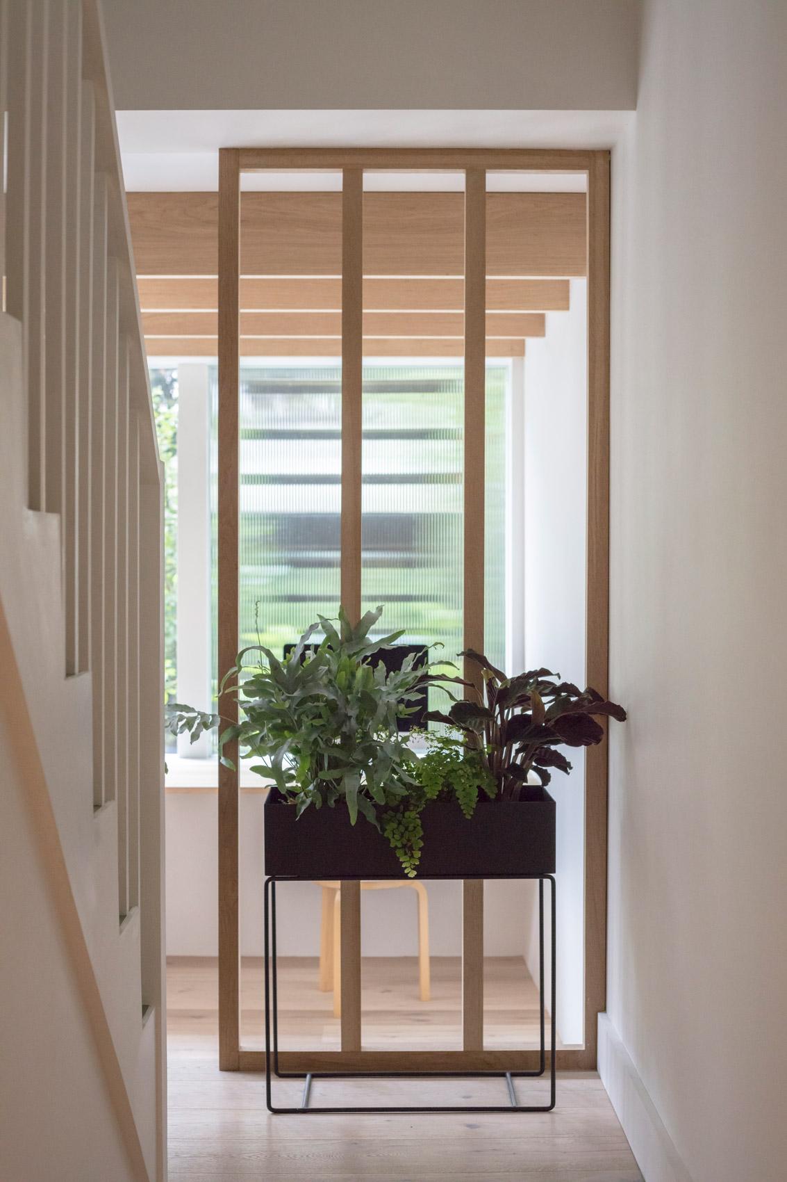 staircase design in wood with plants